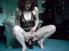 Red-haired Mature Bottle Show