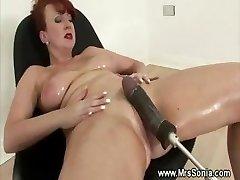 Mature wails orgasm from sex machine