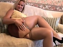 Mature blonde with great body in taut mini skirt