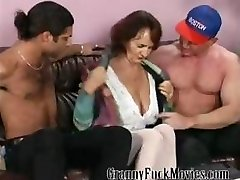 Granny with rigid tits fucking two