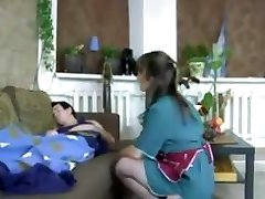 Brown-haired Russian mother in nylons wakes him up for some chisel riding