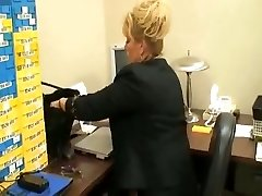 tall mature doll in office with  her foot slave