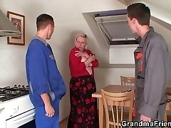 Two repairmen fuck busty grandma from both completes