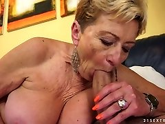 Aroused granny Malya bj's rock hard dick with extreme passion