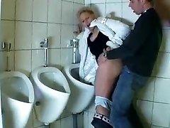 Boy fucks a mature in a public bathroom