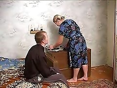 Mature busty lady tempts neighbor boy with monstrous penis into fucking her gently
