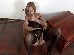 Mature Latina undresses down and pleases herself
