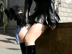 Hot goth MILF in ebony leather mini-skirt upskirt bootie exposed in the streets