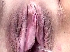 KATHERINE BROWN... Giant pussy, heavy tits laying on her stomach and pissing!