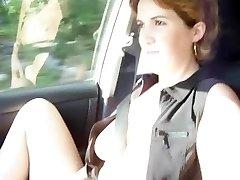 Flashing in her car AP69