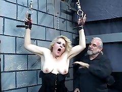 Elder blonde milf gets strapped in for some discipline