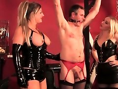 Three latex femdoms dominate some sissy stud