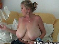 Granny with immense tits masturbates in tights