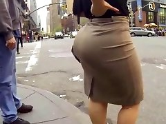 Candid big ass ambling in tight work dress