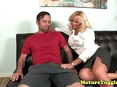 Bigtitted erotic milf tugging shaft on couch