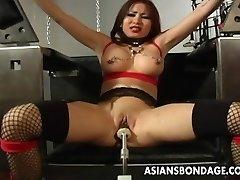 Busty brunette getting her wet muff machine fucked