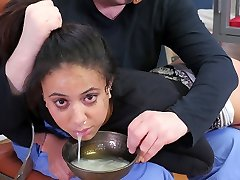 Hot dark-hued submissive girl punished with a bowl of cum