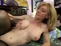 Blonde stockinged MILF sucks young beef whistle the spreads for pussy eating
