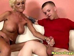 Inked granny tugging midgets hard cock