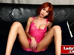 Red-haired ladyboy jerks and cums on herself