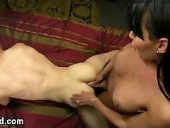 Tied up guy fucked by busty tranny in bed