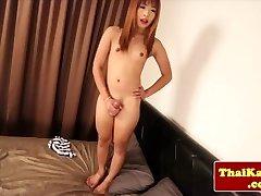 Young diminutive thai tgirl models her ass
