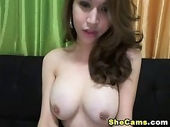 Teasing ladyboy spreads her legs and jerks