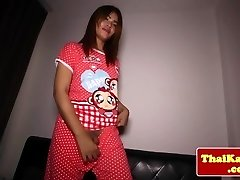 Young thai ladyboy rams toy in butt