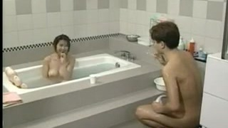Big-boobed Japanese Girl In The Bathroom