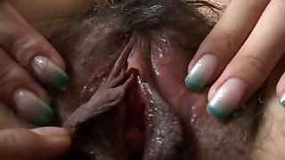 Foxy Japanese beauty gets her extremely hairy pussy fingerblasted by wild wanker