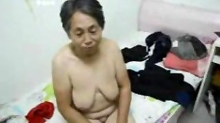 Asian Granny get dressed after sex