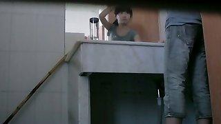 Dark haired asian girl pissing on hidden web cam