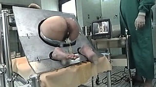 Cougar Bound In A Machine And Takes An Enema In Her Ass