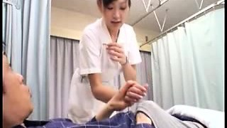 Busty Oriental nurse with hot gams has a patient kneading