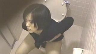 Asian girl wanks on toilet