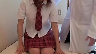 Pretty Japanese schoolgirl exposed in voyeur massage vid
