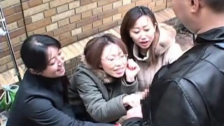 Chinese women taunt man in public via handjob Subtitled