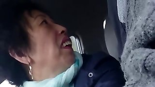 homemade, aged japanese lady wanks cock in car