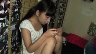 Pigtailed Asian teen in tight white panties flashes her sha