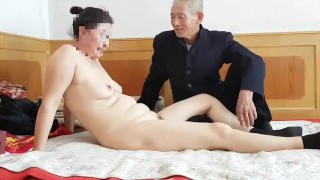 Handsome Chinese grandpa giving porking