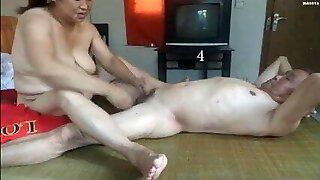 Chinese grandmother is having fun with grandpa
