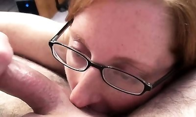 Ginger-haired MILF Layla Redd is on her knees to gulp a shaft