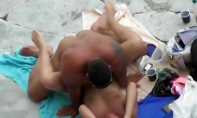 Mature couple passionately Screws on the beach