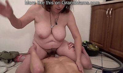Bossy grandmother enjoying a young cock