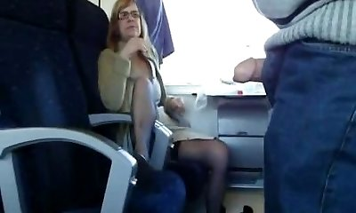 Mature wife deep-throats in train