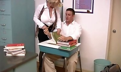 Mature blonde with yam-sized breasts screwed by student in the classroom
