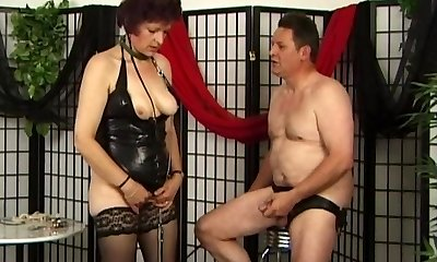 Pervert granny in latex gives oral job