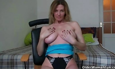 Blond soccer mom demonstrates her big tits and wanton pussy