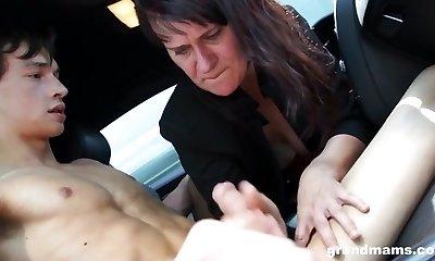 Mature woman handjob in the car