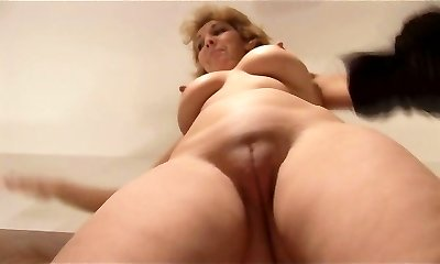 Attractive Mature lady stripping and showing off lovely pussy
